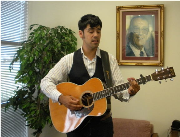 Antonio of K-EARTH 101 performs for us in the lobby, beside our founder Case Hoffman.